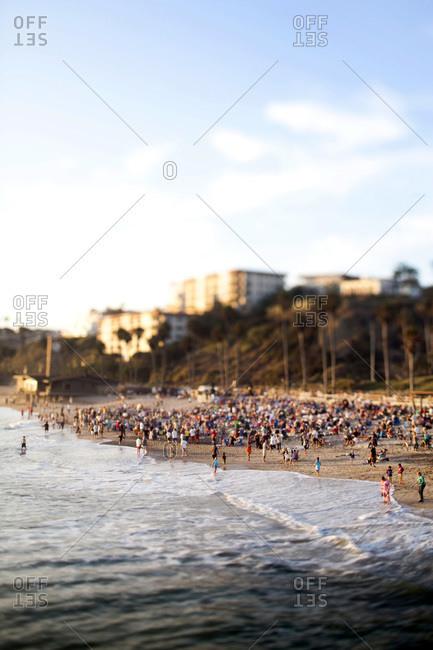 A beach scene at a crowded beach on a sunny day