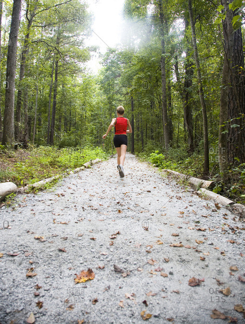 A female runner trains for a marathon in her backyard on numerous trails