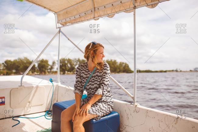 A woman riding a pontoon