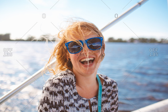 A woman smiling on a boat