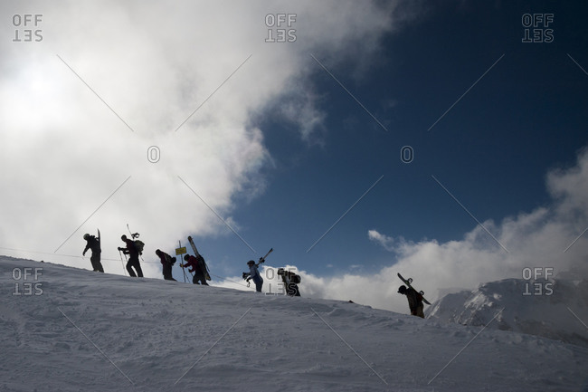 Skiers hiking to back country skiing.