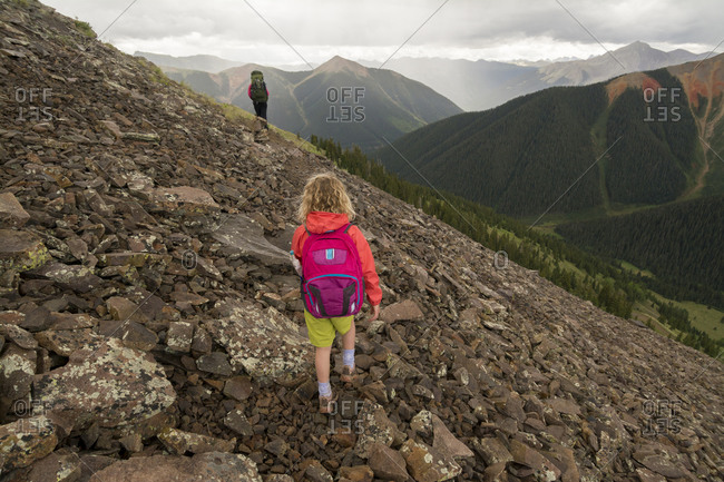 A mother and daughter hiking an alpine trail into Columbine Lake, San Juan National Forest, Silverton, Colorado.