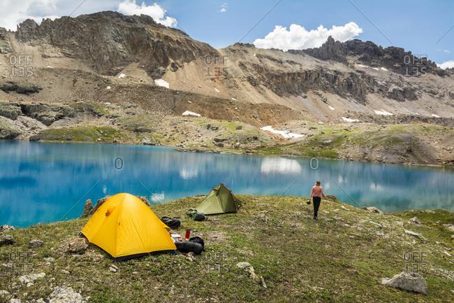 A woman camping near blue lake, San Juan National Forest, Silverton, Colorado.