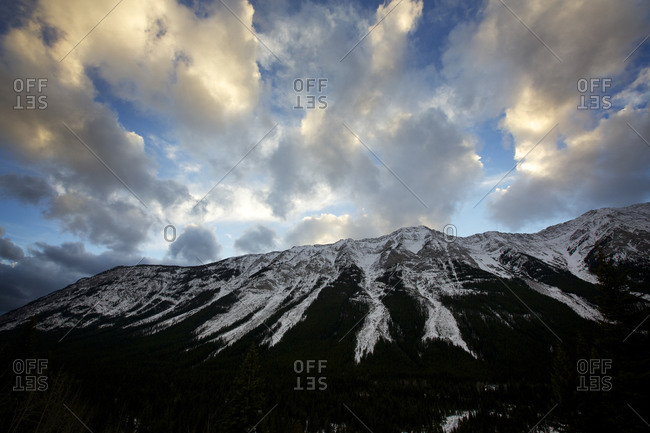 Clouds roll over the mountain tops in Kananaskis, Alberta.