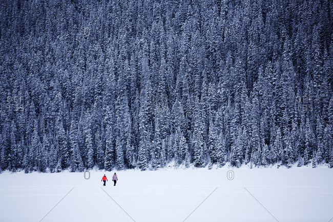 A couple on snow shoes at Lake Louse in Banff National Park, Alberta.