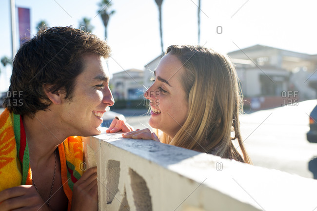 Young couple looks at each other with smiles.
