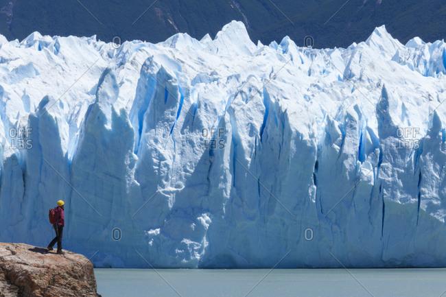 A woman looks over the Perito Moreno glacier.