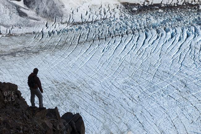 A hiker looks over the Piedras Blancas glacier.