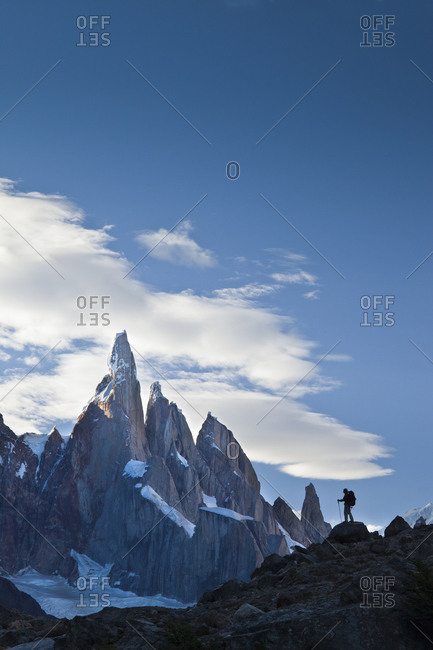 A hiker stands in front of Cerro Torre in Argentina.