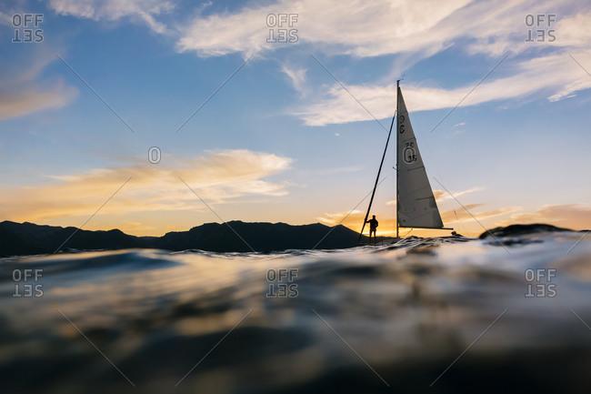 A sailboat on Lake Tahoe at sunset.