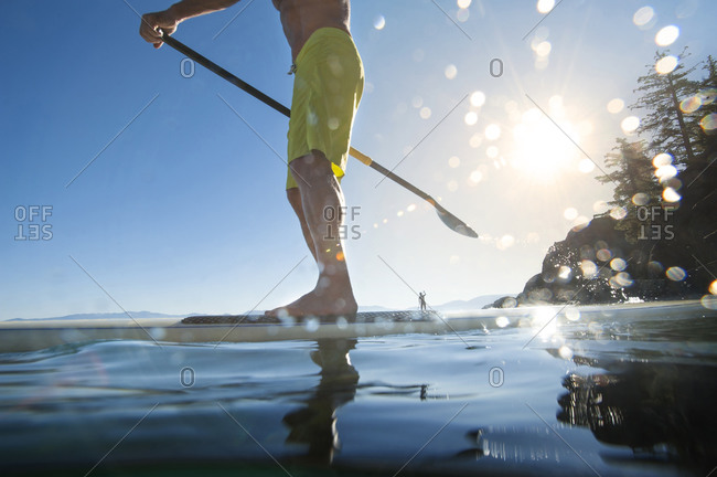 A man stand-up paddle boarding in Lake Tahoe, California.