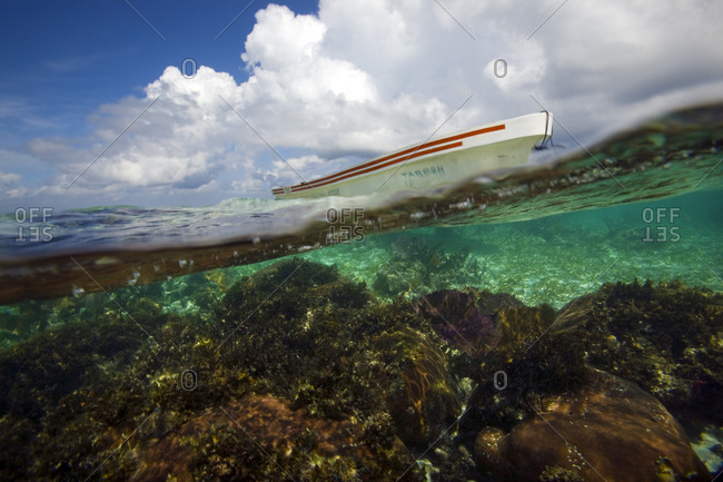 Split view of boat floating in the water in Belize.
