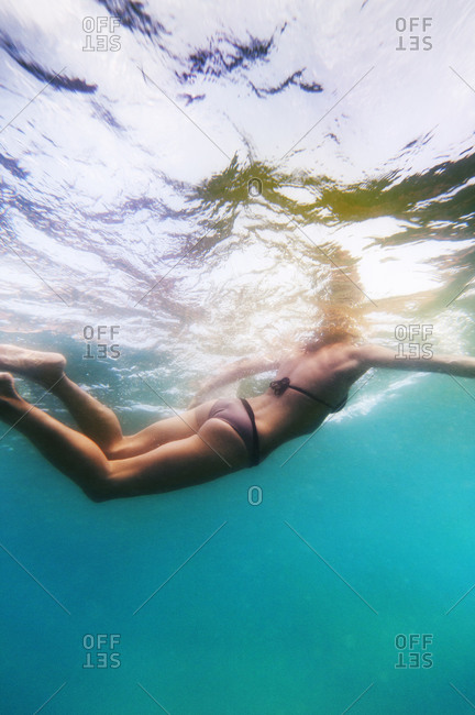Under water view of woman swimming.