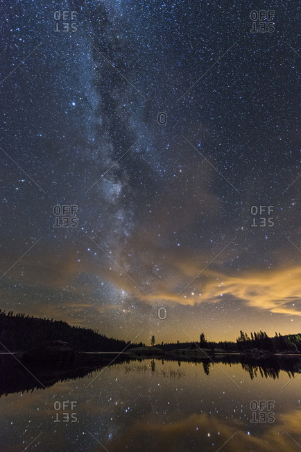 Vertical view of the Milky Way rising up out of Lake Alpine