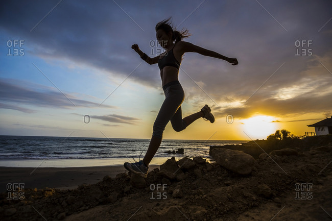Running on the beach in Bali, Indonesia