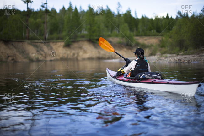 One woman paddles her kayak down the Onon river in northern Mongolia.