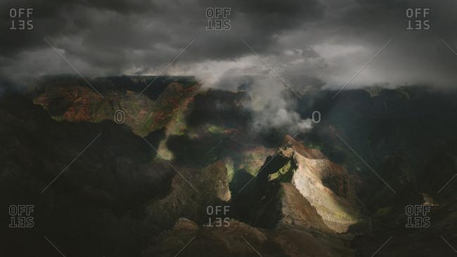 Waimea Canyon spotlighted by clouds