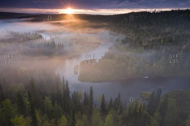 Sunrise over the Kitkajoki River in Oulanka National Park, Finland