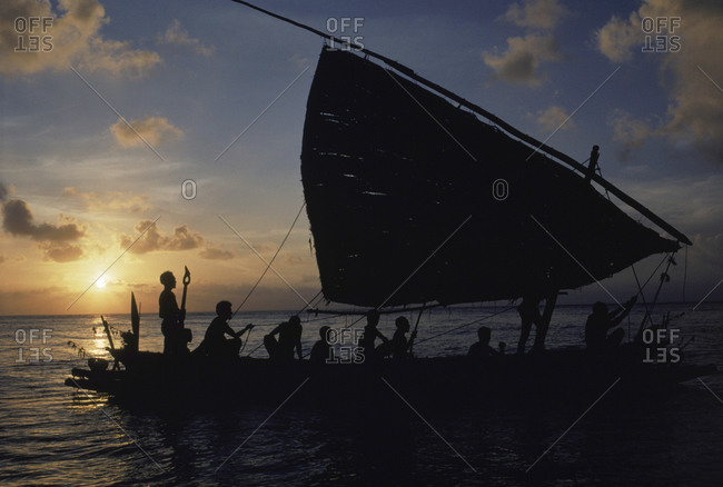 Silhouette of a boat at sunset in Papua New Guinea