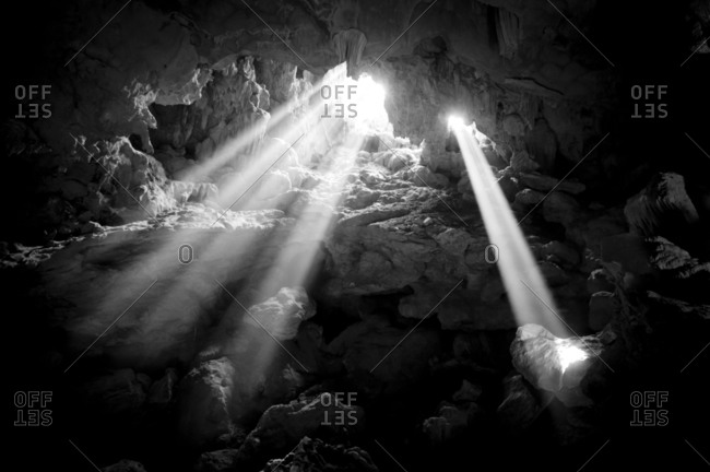 Light rays shine into a cave in Vietnam, Asia