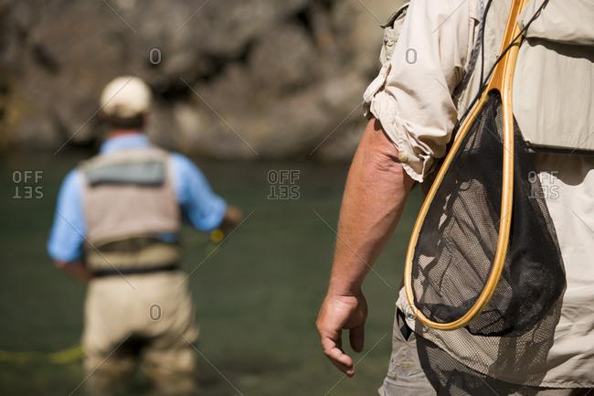 Men fly-fishing in Elk River at East Kootenays, British Columbia, Canada