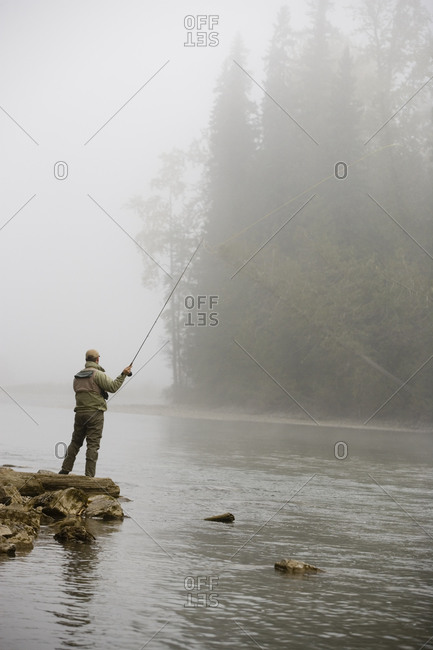 Man fly-fishing at the Elk River in East Kootenays, British Columbia, Canada