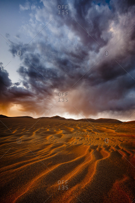 Sand formations and stormy sky in Great Sand Dunes National Park, Alamosa, USA