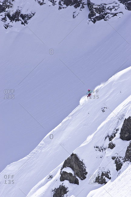 Woman skiing down a steep slope in Fernie, Canada