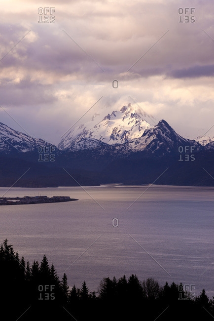 Snow capped mountains behind a bay in Alaska, USA