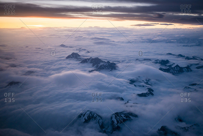 Mountains emerging from clouds in Alaska, USA