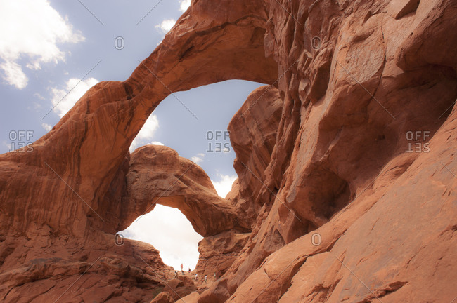 People exploring Double Arch in Arches National Park, Moab, Utah