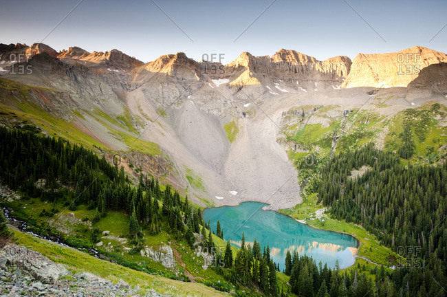 A high mountain lake surrounded by peaks of the Rocky Mountains