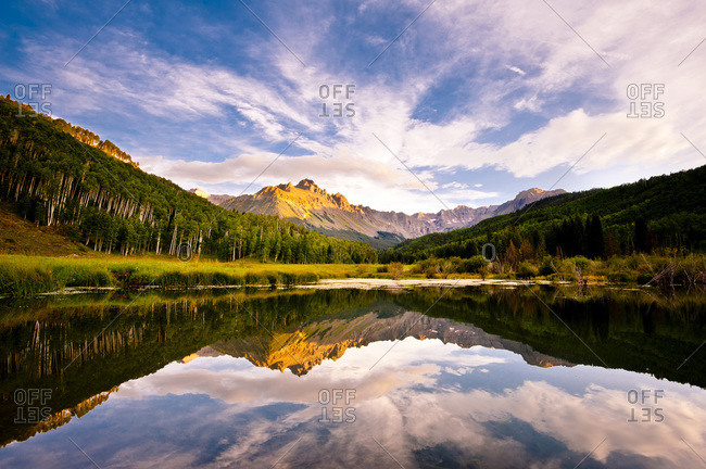 A small pond with Mt Sneffels in Aspen, Colorado, USA
