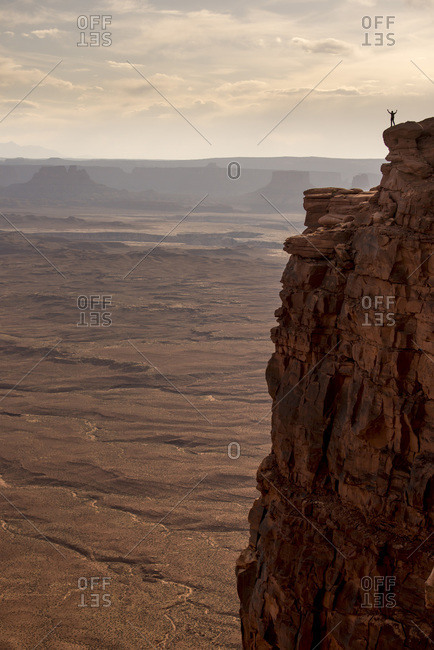 Man standing on a top of a cliff at Canyonlands National Park, Utah, USA