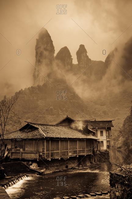 Rock karsts in fog in Dehang, Hunan, China