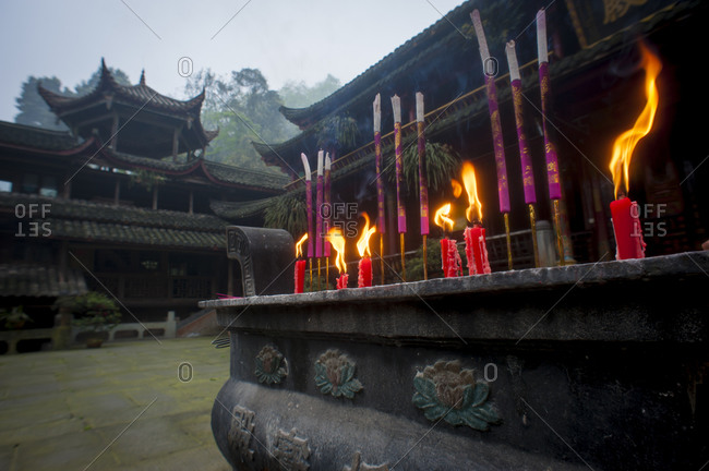 Chinese style structure with prayer candles