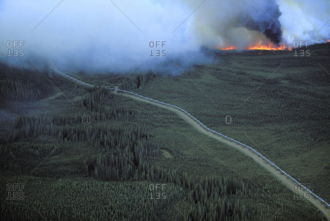 Oil pipelines with forest fire in the north of Fairbanks, Alaska