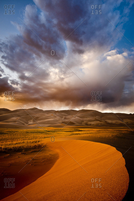 Sand dunes and stormy sky in Great Sand Dunes National Park, Colorado, USA