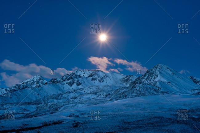 Moonlit mountain range in Kangding, Sichuan, Chian