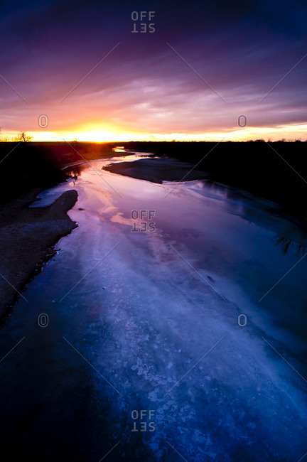 Frozen river at sunset in Lamar, Colorado, United States