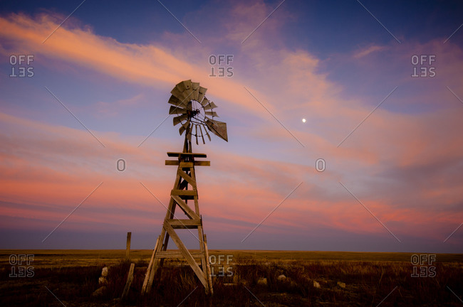 An old wooden windmill at sunset in Lamar, Colorado, USA