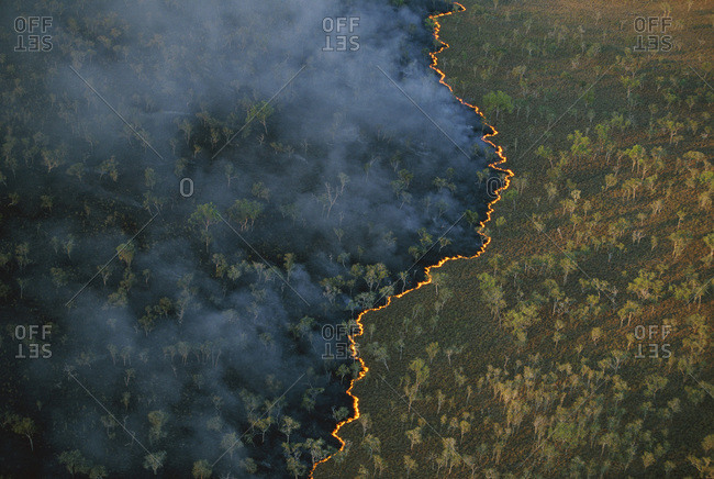 Bushfire set intentionally in the dry season on pasture land near Bachelor, Australia