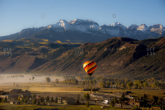 Hot air balloon flying over Ridgway in Colorado, USA