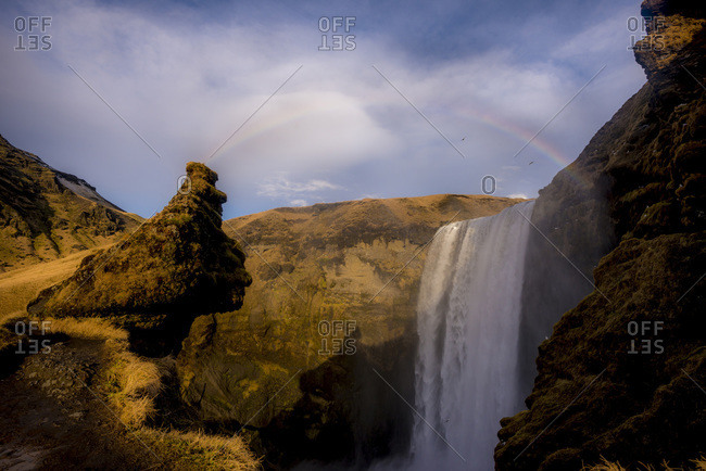 View of a rainbow at Skogafoss waterfall in Iceland