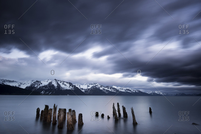 Mountains in the distance under a stormy sky in Seaward, Alaska, USA