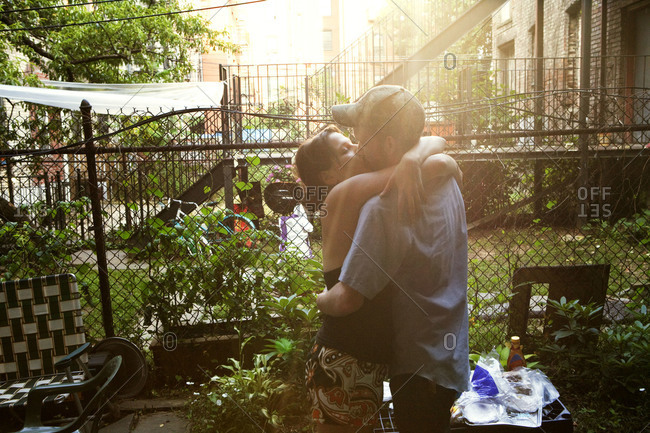 Couple kissing in their backyard