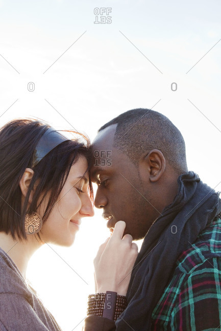Couple touching foreheads