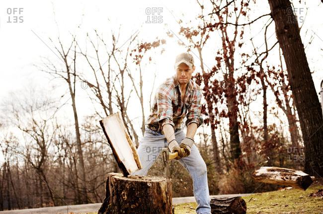 A man chops wood