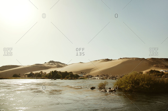 Nile river and dunes in Aswan, Egypt