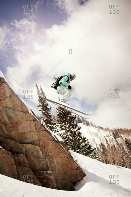 A skier jumping off a cliff